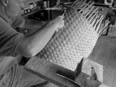 Stephen Zeh carving a basket handle at his shaving horse