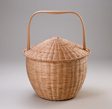 Feather Basket - handcrafted of brown ash by Stephen Zeh, Maine basketmaker.