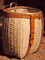 21 in. Maine Packbasket hand woven in brown ash with hand sewn leather work.